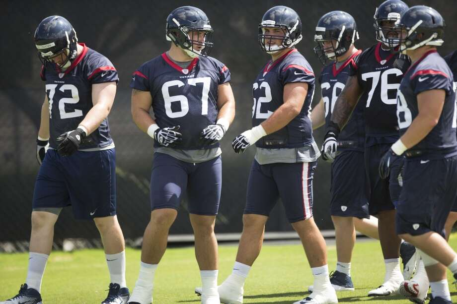 exans offensive linemen Bryan Witzmann (72), Cody White (67), Alex Kupper (62) and Duane Brown (76) get ready for practice. Photo: Brett Coomer, Houston Chronicle