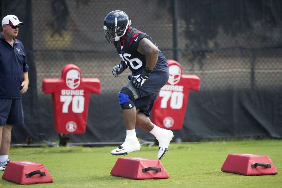 Texans tackle Duane Brown runs a drill. Photo: Brett Coomer, Houston Chronicle