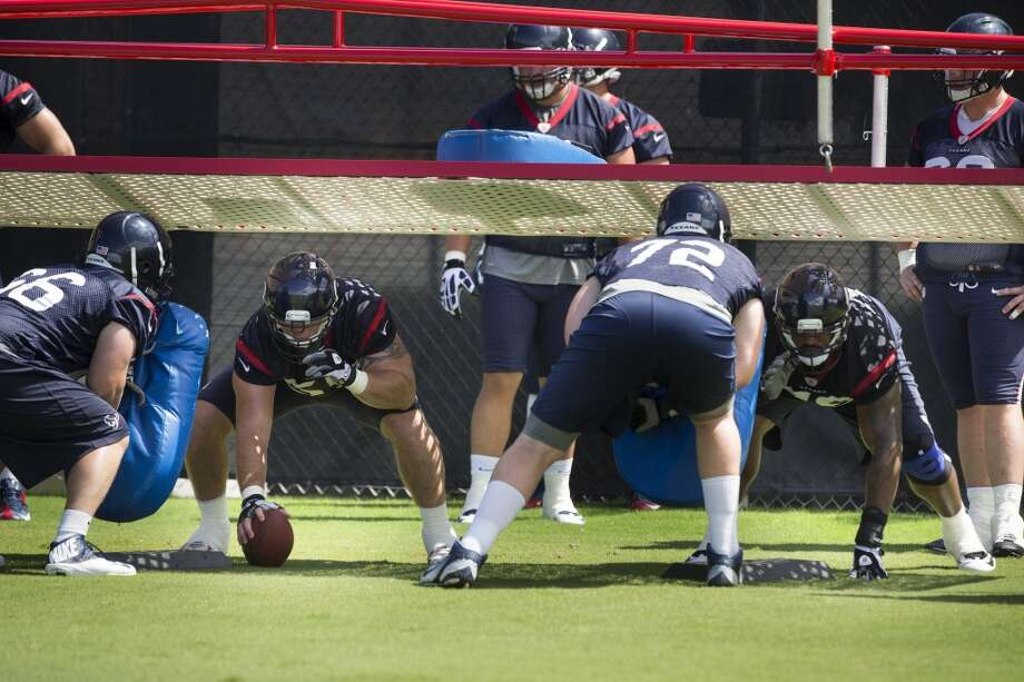 Texans center Chris Myers (55) and Duane Brown (76) get ready to fire off the ball against Conor Boffell (66) and Bryan Witzmann (72). Photo: Brett Coomer, Houston Chronicle