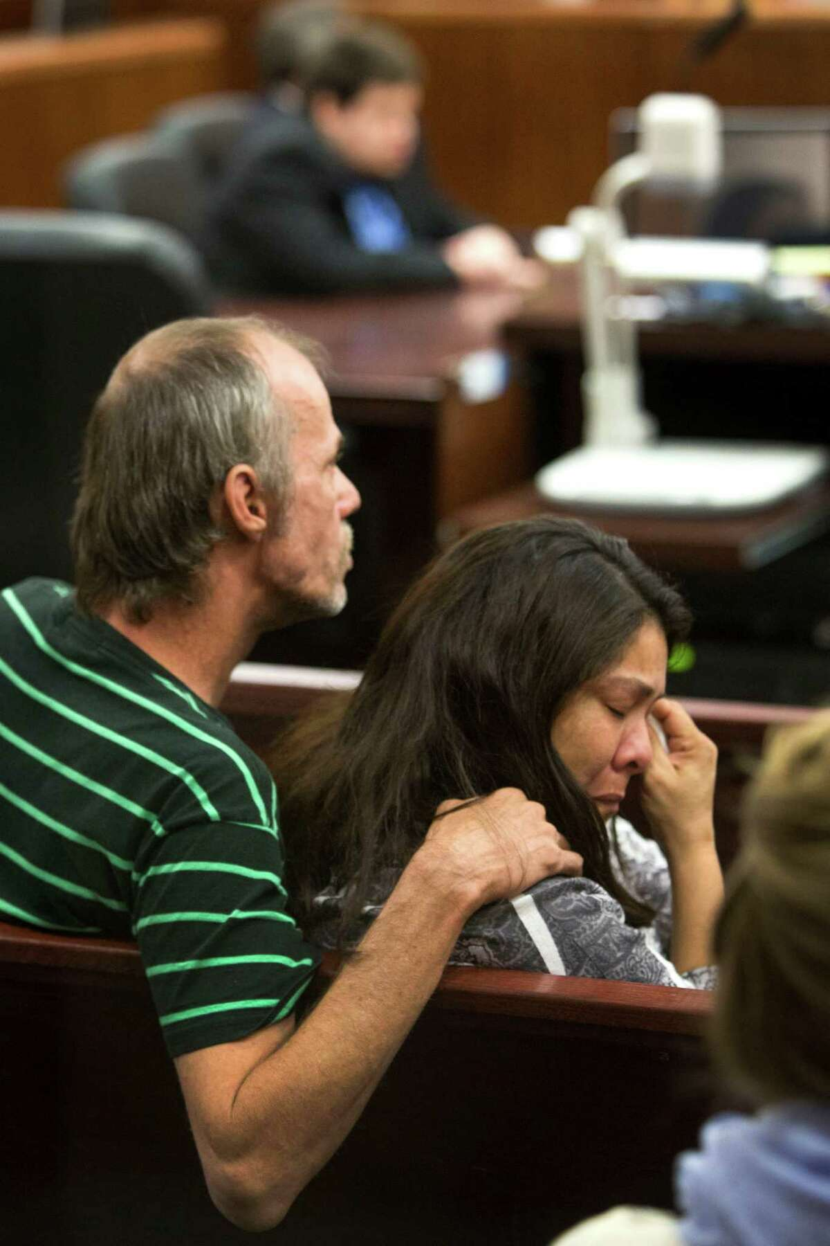 Monica Shiel, aunt of defendant, Justin Wayne Parris, 27, wipes a tear from her eye as she listens to testimony during Parris' murder trial at the Harris County Courthouse Tuesday, June 10, 2014, in Houston. Prosecutors Tuesday said Parris is on trial for the murder of his 81-year-old grandfather, in which he allegedly decapitated him with hedge clippers. Police found Justin Wayne Parris with blood smears on his pants and shirt at the elder man's home in the 900 block of Lamonte on November 6, 2009, according to court records.