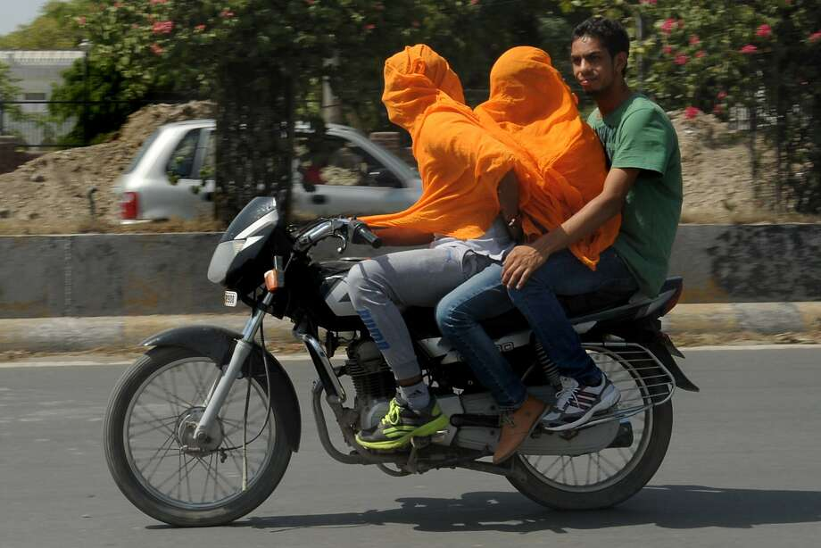 This doesn't look safe: And not just because they're not wearing helmets. (Amritsar, India.) Photo: Narinder Nanu, AFP/Getty Images