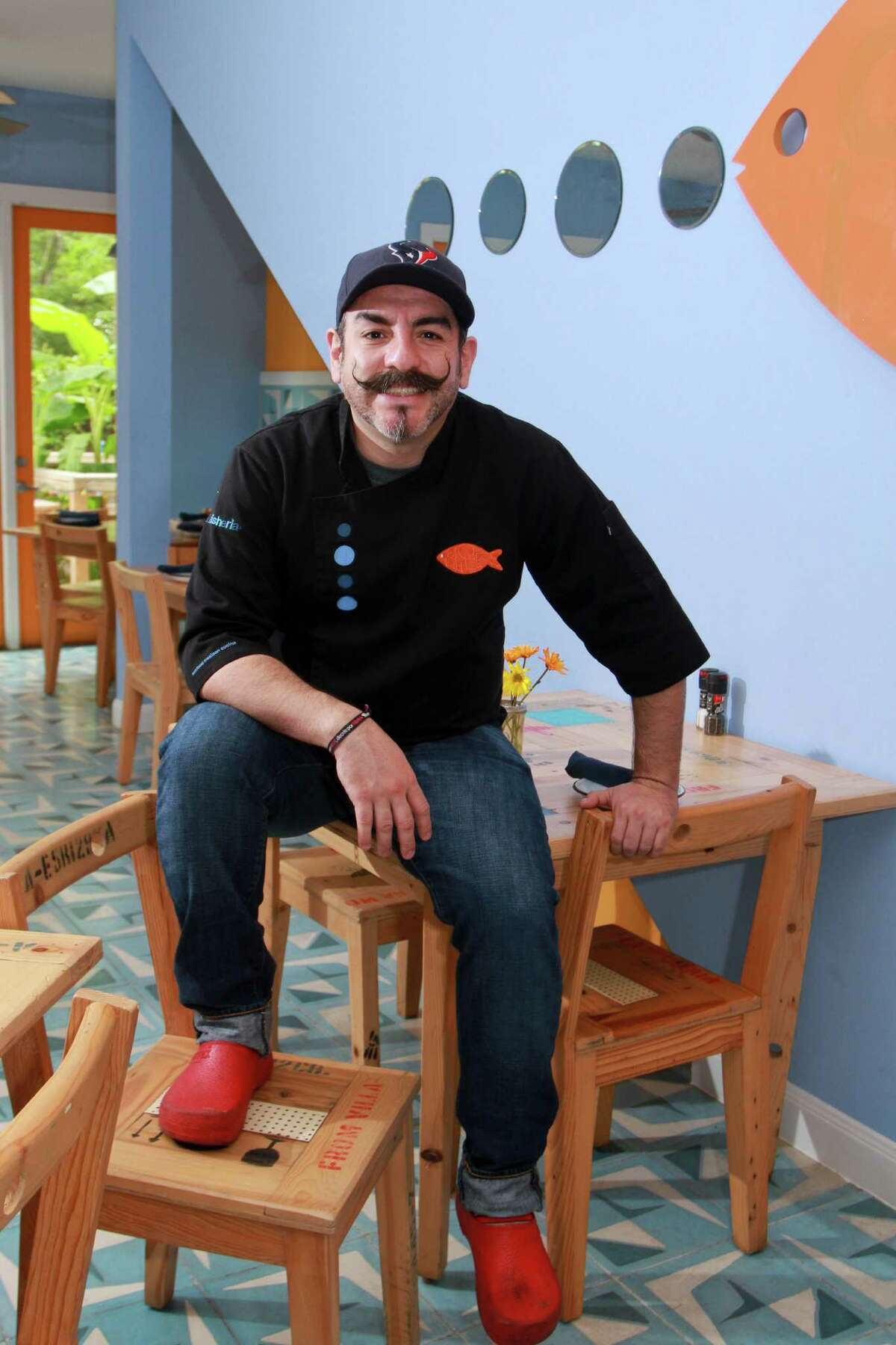(For the Chronicle/Gary Fountain June 3, 2014) Chef Aquiles Chavez of La Fisheria restaurant.