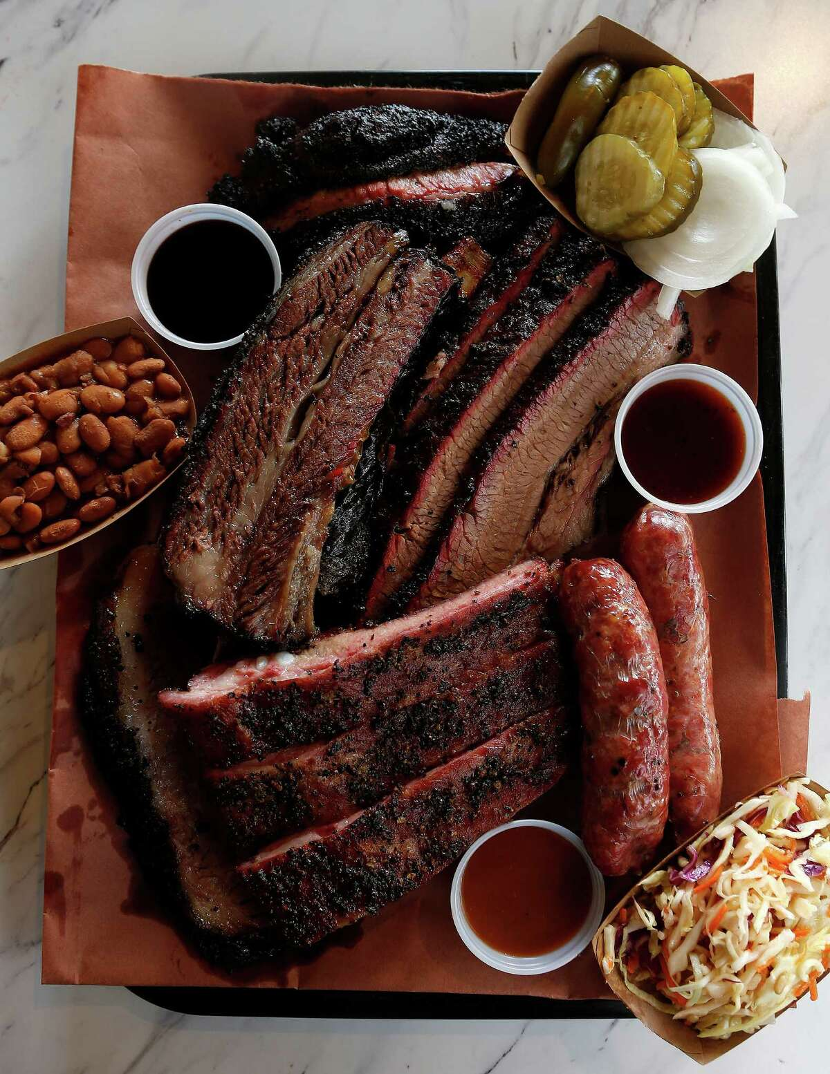 The six-meat plate is served on butcher paper at Killen's Barbecue in Pearland.
