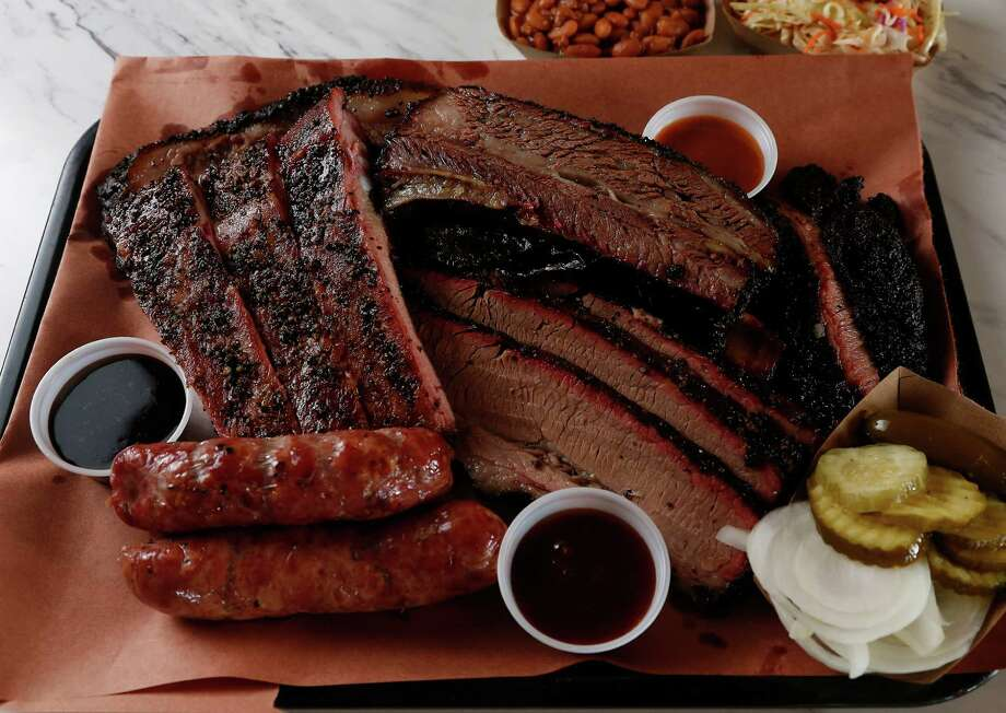 "A four-star review given by Houston Chronicle food critic Alison Cook is a rarity in and of itself. Once you realize her latest top-rated restaurant is a casual barbecue joint out in Pearland, then you really know something special is cooking out in the 'burbs. Killen's Barbecue, located at 3613 E. Broadway in Pearland, wowed Houston Chronicle food critic Alison Cook. From the mellow smoke flavors of the main dishes (which don't necessarily need sauce, mind you) to the surprisingly ""graceful"" desserts, find out why this barbecue joint can hold its own on a national level.Keep clicking to see the delicious eats being served up at Killen's Barbecue. Photo: Karen Warren, Staff / © 2014 Houston Chronicle"