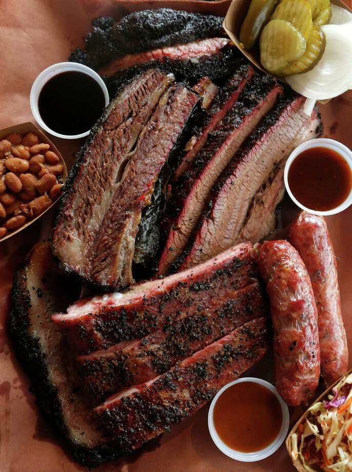 The 6-meat plate on butcher paper at Killen's Barbecue in Pearland.  Photo: Karen Warren, Staff / © 2014 Houston Chronicle