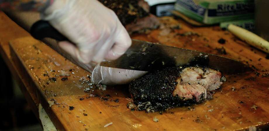 Patrick Feges cuts meat at Killen's Barbecue in Pearland. Photo: Karen Warren, Staff / © 2014 Houston Chronicle