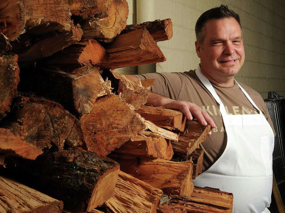 Ronnie Killen uses a variety of woods to fuel the various pits at his barbecue restaurant. Photo: Dave Rossman, Freelance / Freelance