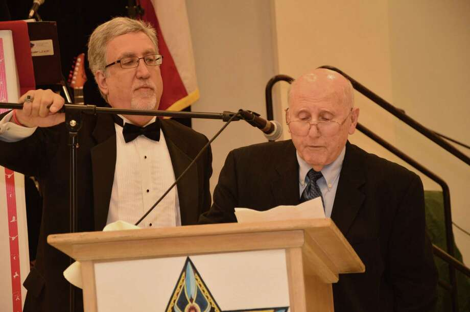 Ron Zaguli, left,  steadies the microphone as Marty Gordon, 80, a four-time past president of the congregation, accepts a plaque awarded to him on the 50th anniversary of Shaar Hashalom,  a Clear Lake-area synagogue. Photo: Jimmy Loyd / freelance