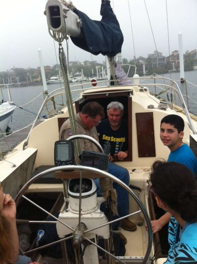 Marcus Sexton, left, Bryan Talley and Chris Oliveras  prepare for a sail. Photo: Courtesy