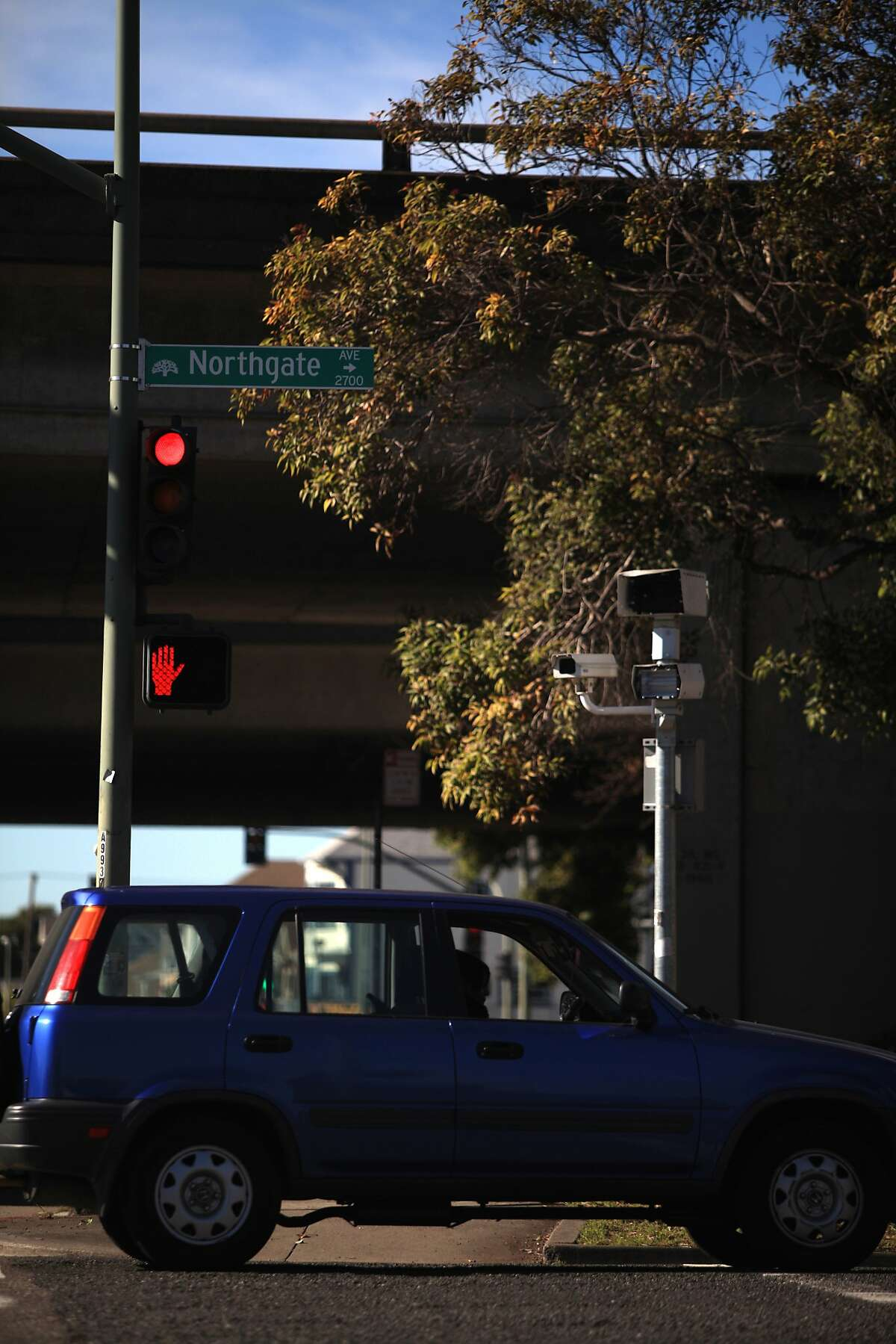 A red light camera unit is seen at the 27th St. and Northgate Avenue next to an on ramp to I-580 on Thursday, February 2, 2012 in Oakland, Calif.