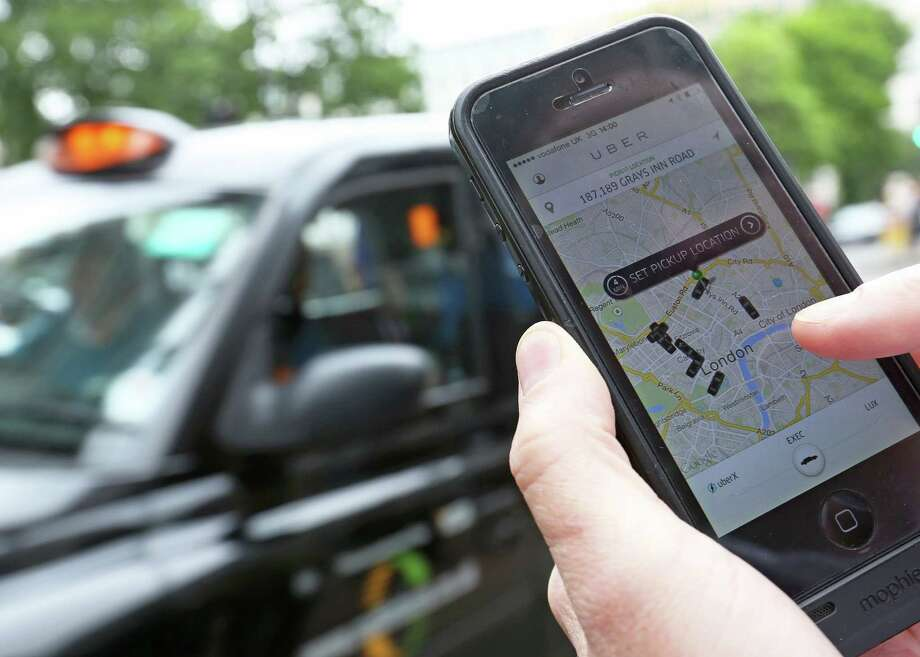 A user scans for an available vehicle using an Uber  app. Uber might have drawbacks, but so does regular taxi service. Photo: Chris Ratcliffe / Bloomberg / © 2014 Bloomberg Finance LP.