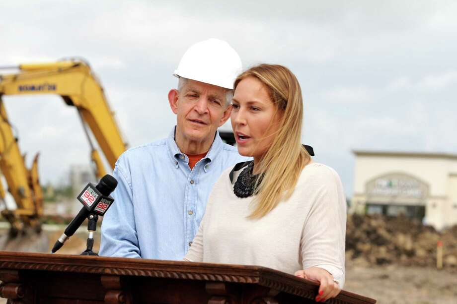 "Jim ""Mattress Mack"" McIngvale listens as his daughter, Laura McIngvale Brown, a University of Houston, Hilton School of Hotel and Restaurant Management alumni, speaks about the restaurant that she will manage at the new location.    Jim ""Mattress Mack"" McIngvale listens as his daughter, Laura McIngvale Brown, a University of Houston, Hilton School of Hotel and Restaurant Management alumni, speaks about the restaurant that she will manage at the new location. Photo: Suzanne Rehak, Freelance Photographer"