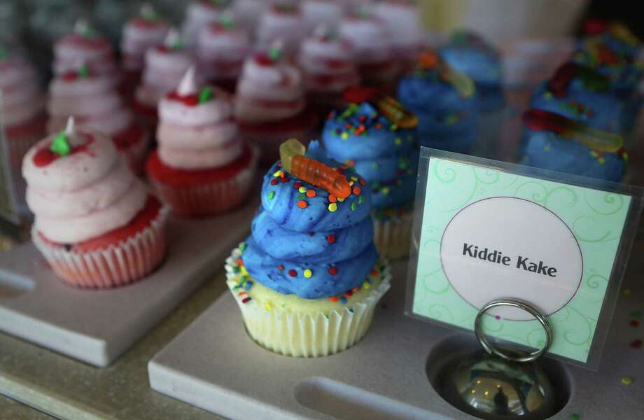 Cupcakes from Gigi's Cupcakes won the reader vote for best cupcakes in San Antonio in the annual Reader's Choice poll.  At right is the Kiddie Kake and left is the Strawberry Shortcake.  Wednesday, May 28, 2014. Photo: San Antonio Express-News / © 2012 San Antonio Express-News