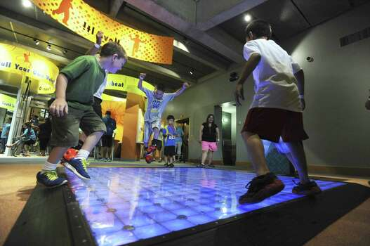 "Children play on the ""Move It"" station after the ribbon cutting for the new H-E-B Body Adventure Exhibit at The Witte Museum last month. Photo: Billy Calzada / San Antonio Express-News / San Antonio Express-News"