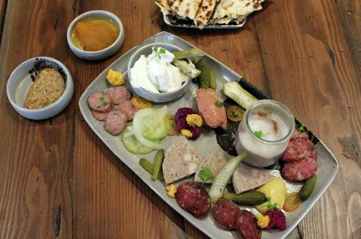 Cured features a daily selection of a dozen or so charcuterie options that are cured from 60 to 120 days. Guests can select three, six or nine items. Photo: Jennifer McInnis / San Antonio Express-News / San Antonio Express-News