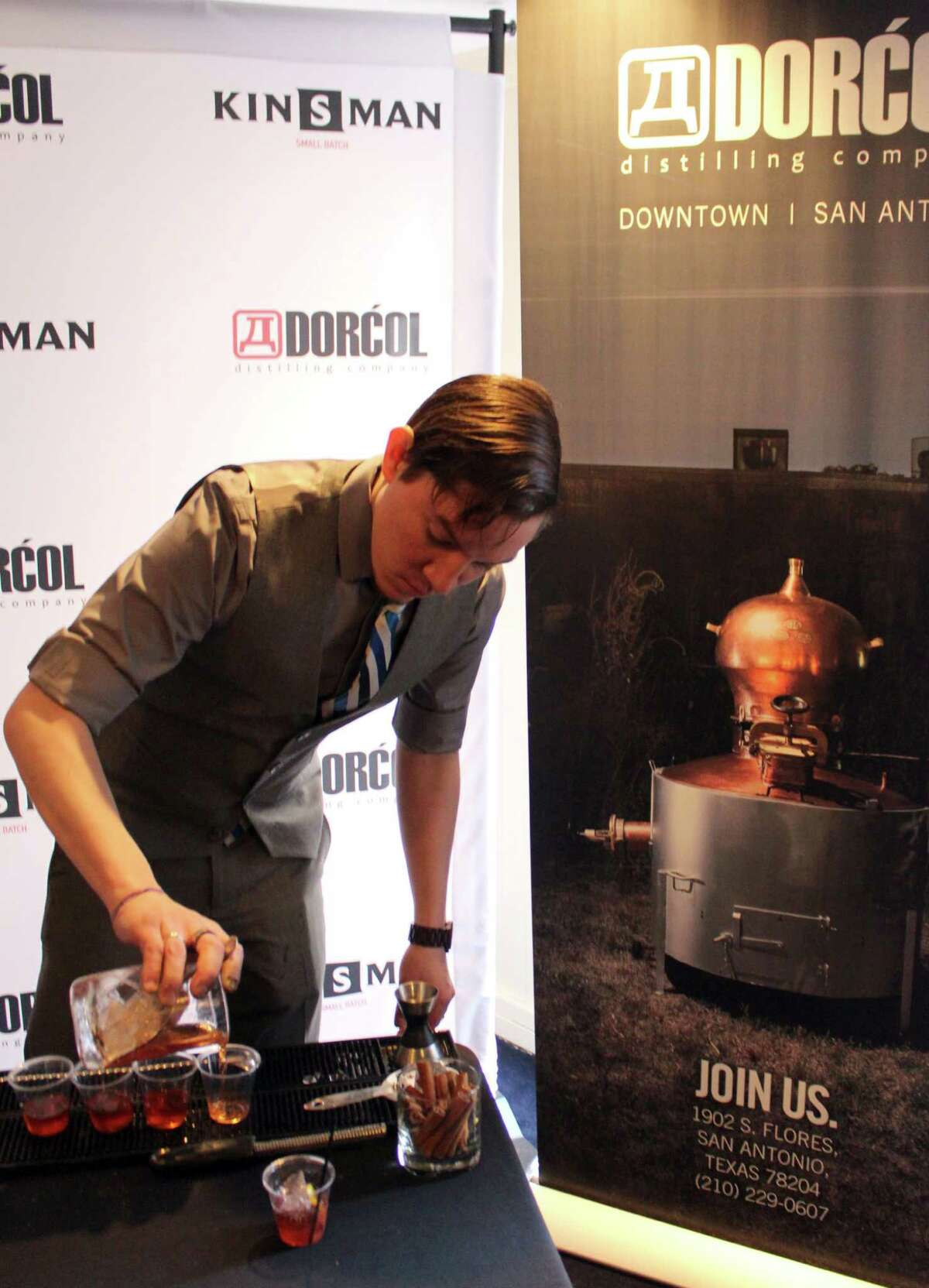 A bartender for Dorcol Distilling Co. makes drinks during the San Antonio Cocktail Conference.