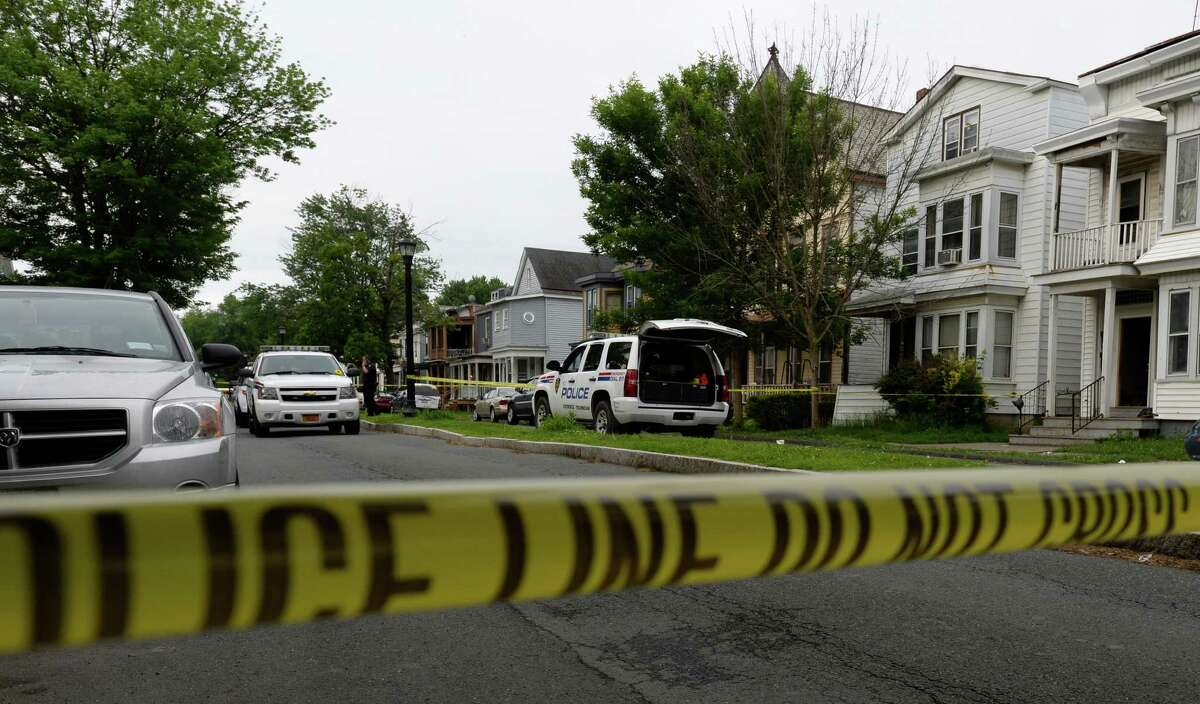 Troy Police investigate an early morning homicide at 93 6th Avenue Tuesday, June 10, 2014, in Troy, N.Y. (Skip Dickstein / Times Union)