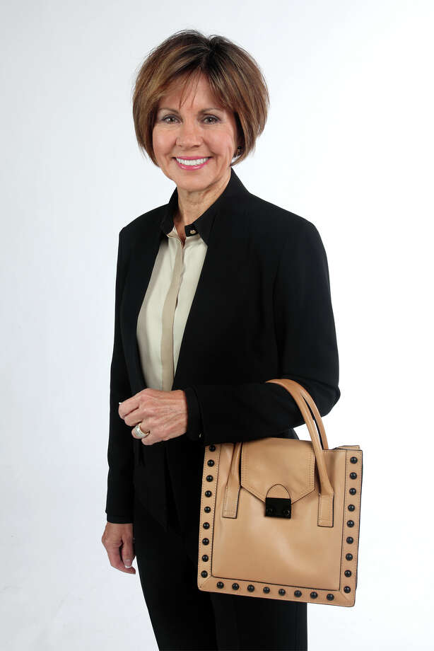 City Manager Sheryl Sculley likes the straight lines of her classic-looking purse. Photo: Juanito M. Garza, San Antonio Express-News / San Antonio Express-News