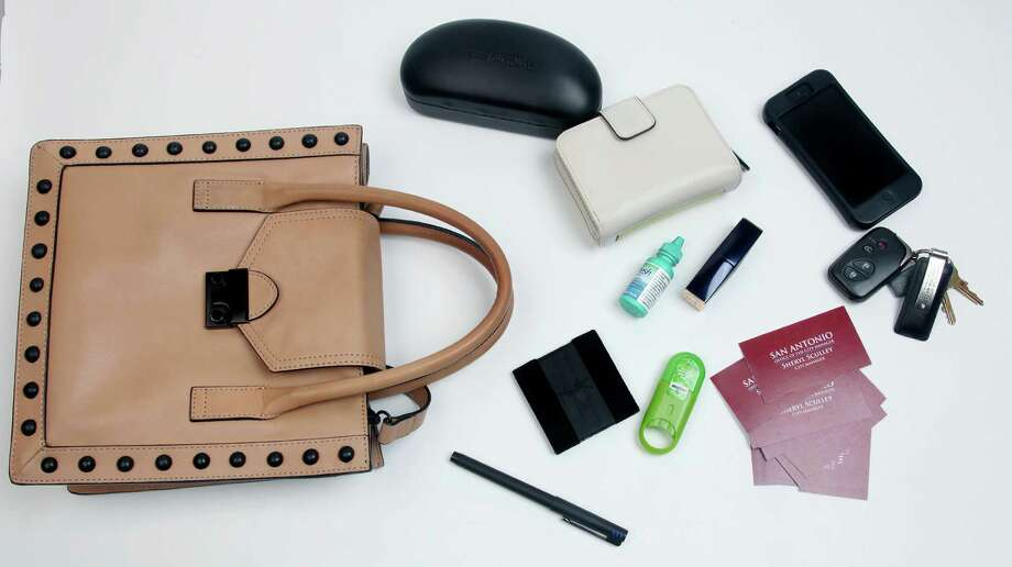Eye drops, lipstick, business cards and an iPhone are among the contents of Sculley's uncluttered bag. Photo: Juanito M. Garza, San Antonio Express-News / San Antonio Express-News