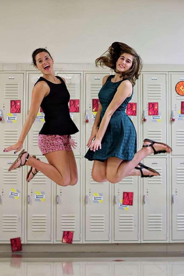 Pope John XXIII High School valedictorian Cameron Fay McHugh, left, and salutatorian Ashley Briana Kopf are excited about the start of summer.