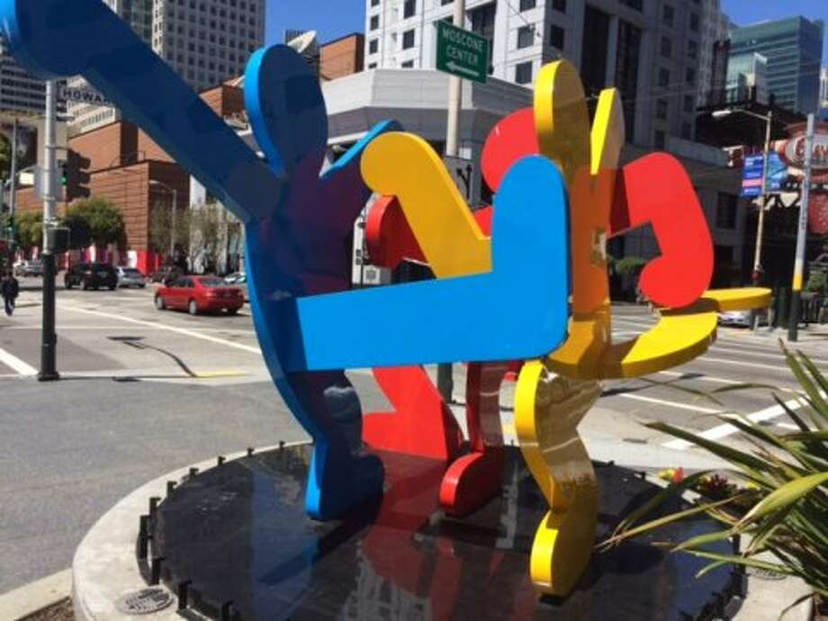 """Three Dancing Figures,"" Keith Haring's sculpture at 4th and Howard streets. The Chronicle/Sam Whiting"