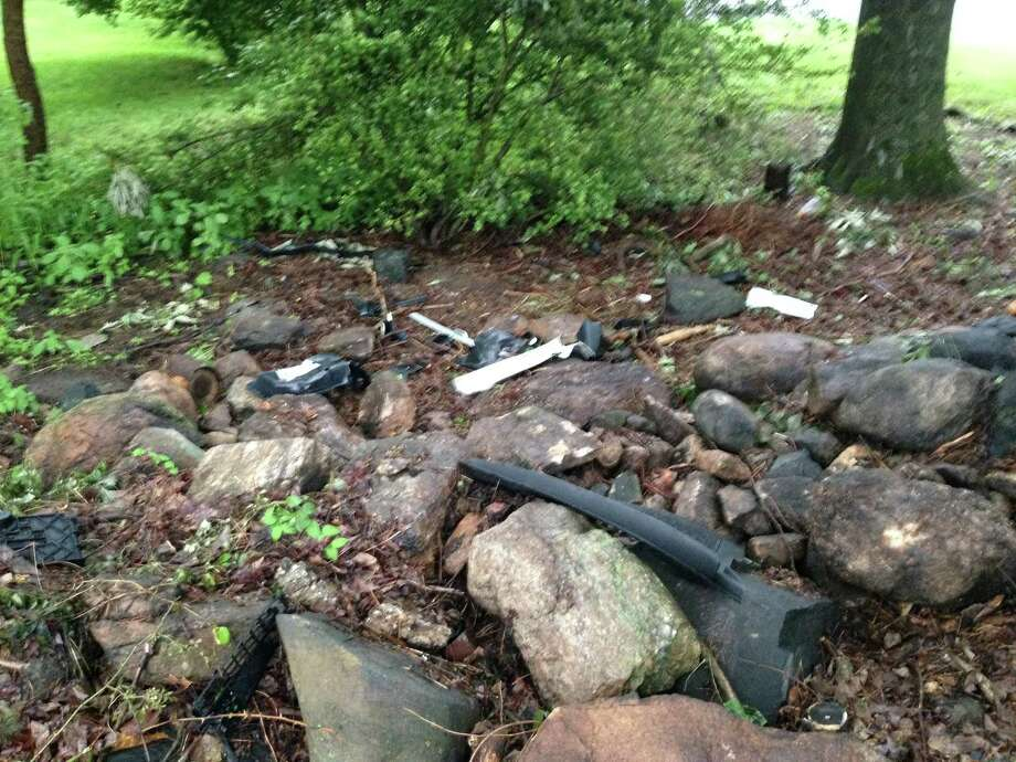 Debris from the 2015 Audi A3 that a Darien man crashed into a tree on Nearwater Lane remained on Monday afternoon. Police said speed played a role in the one-car accident. Photo: Megan Spicer / Darien News