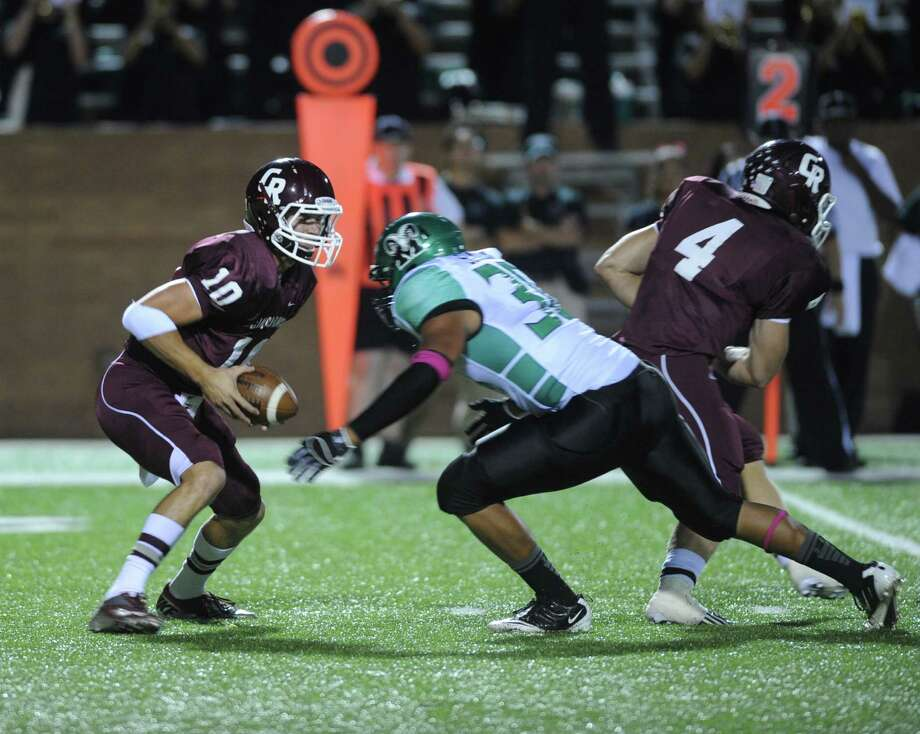 Mayde Creek's Mark Simon (above) hopes to provide a fearsome presence on defense as  Cinco Ranch grad Sam Straughan (below) also does on offense at Saturday's Bayou Bowl. Photo: Eddy Matchette, Freelance / Freelance