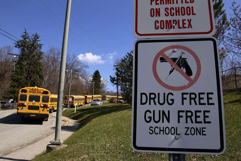Buses line up to take students after 21 students and a security guard were stabbed April 9 by a 16-year-old boy at Franklin Regional High School in the Pittsburgh suburb of Murrysville. Photo: Gene J. Puskar, Associated Press