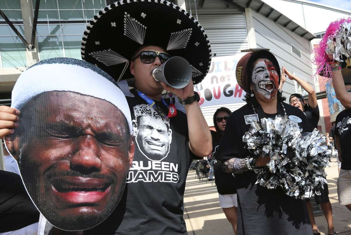 Lupe Lemos, left, and Brenda Flores cheer for their team before game two of the NBA Finals between the San Antonio Spurs and the Miami Heat at the AT&T Center, Sunday, June 8, 2014. The Spurs lead the series, 1-0.