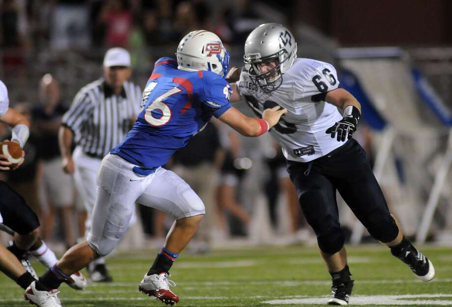 Oak Ridge linebacker Clayton Grett, left, is among four Conroe ISD graduates to feature in the Bayou Bowl this weekend. Photo: Jerry Baker, Freelance