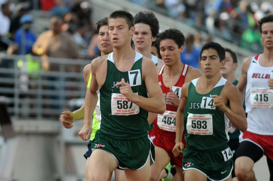 Strake Jesuit seniors Robert Ammons, center, and Frank Lara, right, capped their high school running careers at the UIL Class 5A Track and Field Championships, leading Strake Jesuit to District 19-5A titles in boys cross country and boys track and field, the Crusaders' only titles in UIL-sanctioned sports. Photo: Jerry Baker, Freelance
