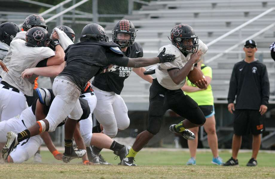 Running back Micah Massey leads a strong core of returnees for St. Pius X who starred in spring practices in front of new coach Stephen Hill. Photo: Jerry Baker, Freelance