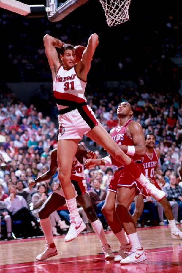Portland Trail Blazers  1st round - 2nd overall  Sam Bowie - University of Kentucky  Widely regarded as the biggest draft bust in NBA history. Named to All-Rookie team, then broke his left leg in 1985 and right leg in 1986. He played for three teams during his injury-plagued 10-year NBA career. Photo: Brian Drake, NBAE/Getty Images / 1985 NBAE