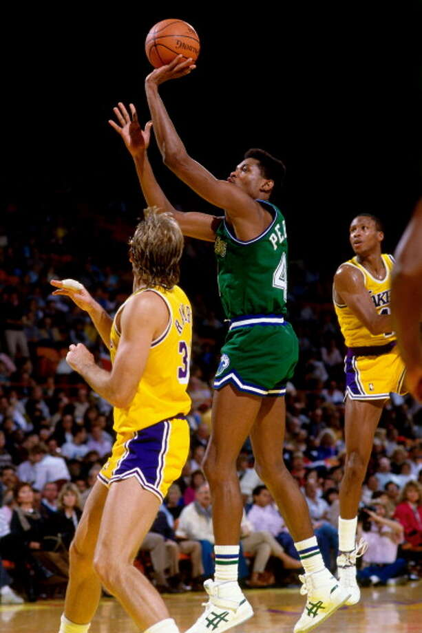 Dallas Mavericks  1st round - 4th overall  Sam Perkins - University of North Carolina Perkins played for four teams during his 17-year NBA career. He won an Olympic gold medal at the 1984 Games. He attended the University of North Carolina, where he was a teammate of future Hall of Famers James Worthy and Michael Jordan. He tied an NBA record by hitting 8 three-pointers without a miss in 1997. Photo: Andy Hayt, NBAE/Getty Images / 1985 NBAE