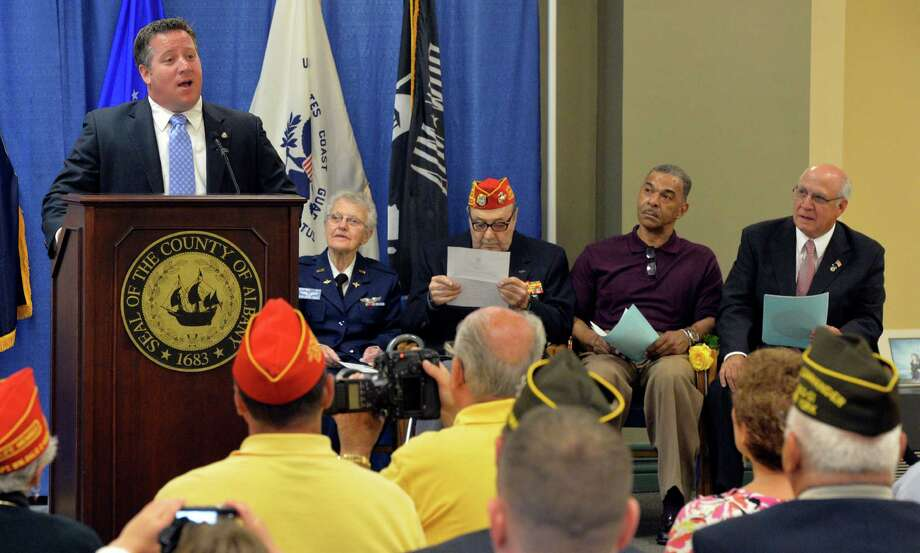 Albany County Executive Dan McCoy gives the opening speech Tuesday morning, June 10, 2014, during the Albany County Veterans Recognition Program held at the Albany County offices in Albany, N.Y.  Four veterans were honored for their service and their lasting impact on the community. (Skip Dickstein / Times Union) Photo: SKIP DICKSTEIN / 00027196A
