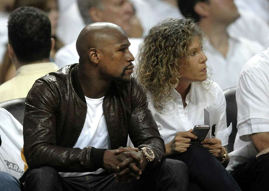 Boxing legend Floyd Mayweather watches the first half of Game 4 of the NBA Finals between the Miami Heat and the San Antonio Spurs at American Airlines Arena in Miami on Thursday, June 12, 2014.  Photo: Michael Laughlin, McClatchy-Tribune News Service / Sun Sentinel