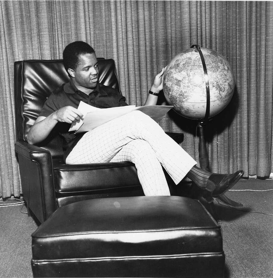 Founder of Motown Records and king of the Motown era, Berry Gordy Jr, poses in his office looking at a globe in 1966 in Detroit, United States. Photo: Gilles Petard, Getty / 1966 Gilles Petard