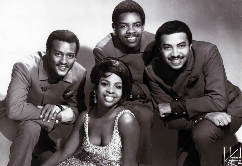 """Gladys Knight & The Pips pose for a picture in 1966. Active from 1953 to 1988 when Knight decided she wanted to go solo. The Knight and the Pips are probably best known for their version of """"Heard it Through The Grapevine"""" in 1967, """"Neither One of Us (Wants to Be the First to Say Goodbye)"""" in 1973, and """"Midnight Train to Georgia,"""" also in 1973. From left to right, Edward Patten, Gladys Knight, Bubba Knight and William Guest.  Photo: Gilles Petard, Getty / Redferns"""