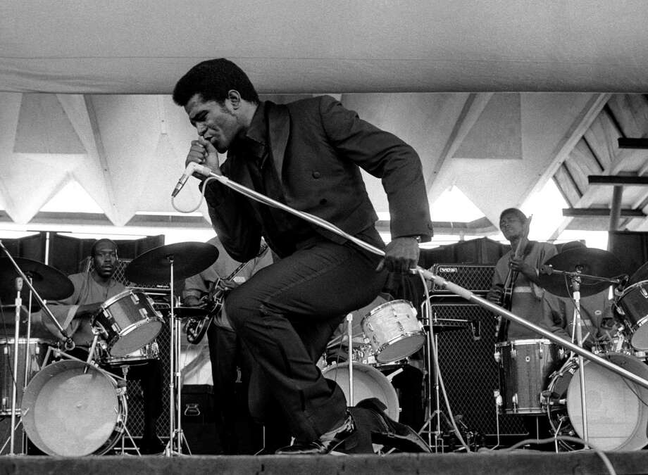 """Godfather of soul James Brown never recorded for Motown, but became one of the most iconic funk performers of the century with his high energy moves and nearly unintelligible call and response breakdowns.  Brown is perhaps most famous for his songs, """"I Got You (I Feel Good)"""" (1965), """"Papa's Got a Brand New Bag"""" (1965), and """"Get Up (I Feel Like Being a) Sex Machine"""" (1970). Here, Brown performs onstage at the Newport Jazz Festival on July 6, 1969 in Newport, Rhode Island. Photo: Tom Copi, Getty / Michael Ochs Archives"""