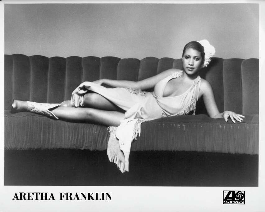 "Soul singer Aretha Franklin started her career in gospel before changing to a more secular tone in 1960 when she signed to Columbia Records. True success didn't hit Franklin until she changed from Columbia to Atlantic Records in 1967. With Atlantic, Franklin would go on to release chart-toppers such as, ""Respect"" (1967), ""(You Make Me Feel Like) A Natural Woman"" (1967), and ""Think"" (1968). Here, she poses for a portrait lying on a couch in 1973. Photo: Michael Ochs Archives, Getty / Michael Ochs Archives"