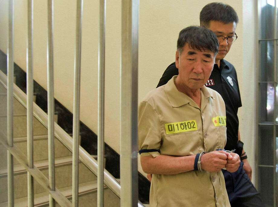 Lee Joon-seok, the captain of the sunken South Korean ferry Sewol, arrives at Gwangju District Court in Gwangju, South Korea, Tuesday, June 10, 2014. Fifteen crew members from the sunken South Korean ferry were in court to enter pleas on charges that they were negligent and failed to save passengers in the disaster, which left more than 300 people dead or missing. (AP Photo/Yonhap, Hyung Min-woo)  KOREA OUT Photo: Hyung Min-woo, SUB / Yonhap