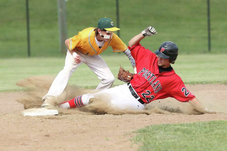 Trinity Catholic's #1 Kyle Kashian makes the out on Portland High School's #22 Nick Adamsons  during Tuesday afternoon Class S semi-finals held in Berlin, CT. Photo: Mike Ross / Mike Ross Connecticut Post freelance -www.mikerossphoto.com