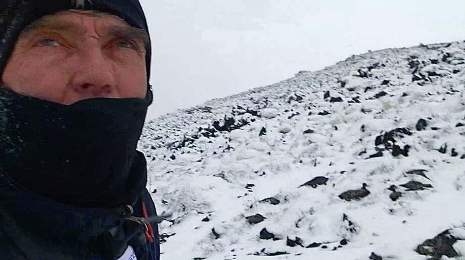 """Greenwich resident Luc Hardy bundles up against the elements during his recent attempt to scale Mt. Damavand in Iran.  The caption he provides reads """"Approaching high camp - 4200m- wind, snow, coldâĦ Thursday, May 15 - 2014 / Damavand âÄì IRAN"""" Photo: Contributed Photo / Greenwich Time Contributed"""