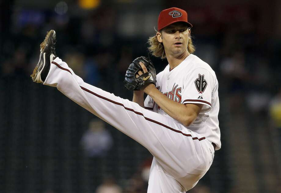 Arizona Diamondbacks' Bronson Arroyo winds up to throw a pitch against the Houston Astros during the first inning of a baseball game on Tuesday, June 10, 2014, in Phoenix. (AP Photo/Ross D. Franklin) Photo: Ross D. Franklin, Associated Press