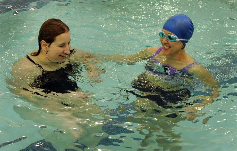 Karen Black, 32, of Newtown, Conn., left, works with Jean Curri, 40, of Bewster, N.Y., during an adult beginners swimming course at The Dive Shop Aquatic Center in Brookfield, Conn. Sunday, June 8, 2014. Photo: Carol Kaliff / The News-Times