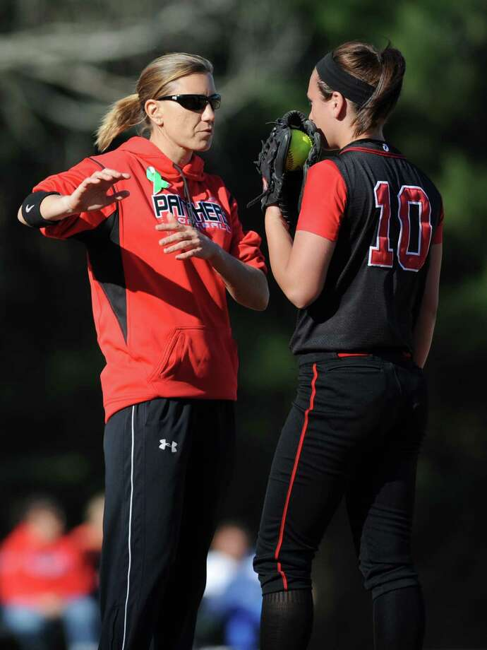 Masuk coach Jacqui Sheftz talks with pitcher Tatum Buckley during undefeated Masuk's 6-0 softball victory over Newtown at Masuk High School in Monroe, Conn. on Friday, May 3, 2013. Photo: Tyler Sizemore / The News-Times
