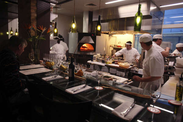 The visual anchor of the kitchen  is the  pizza oven, which draws many compliments from the bar.