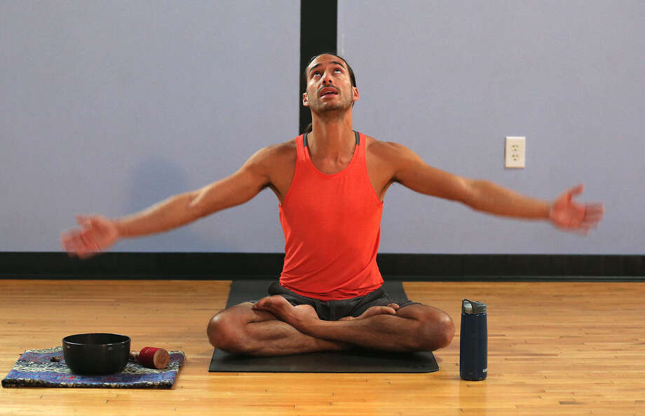 Yoga instructor Mark Bennett conducts a lunchtime class at The Synergy Studio. The studio holds more than 50 classes a week at their site in The Pearl. Photo: Jerry Lara / San Antonio Express-News / © 2014 San Antonio Express-News