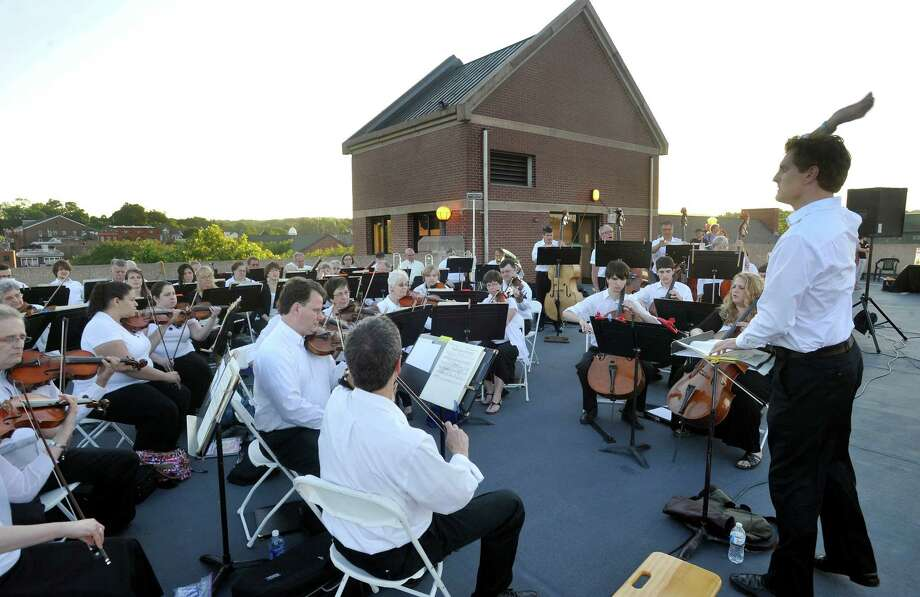 The Danbury Symphony Orchestra Classic Pops Under the Stars concert Saturday, June 16, 2012, was held on the roof of the Patriots Parking Garage since the bandshell was destroyed in an October storm. Photo: Michael Duffy / The News-Times
