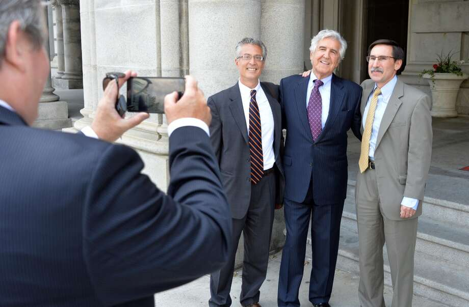 Ken Bruno, left, takes a snapshot of former State Senator Joseph Bruno, flanked by his former senate counsels Michael Avella, left, and Michael Rosen, right, outside the State Capitol Tuesday, June 10, 2014, in Albany, N.Y. (John Carl D'Annibale / Times Union) Photo: John Carl D'Annibale, Albany Times Union